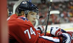 Washington Capitals defenseman John Carlson (74) looks on during the second period of an NHL hockey game against the Philadelphia Flyers, Friday, Feb. 1, 2013, in Washington. (AP Photo/Nick Wass)