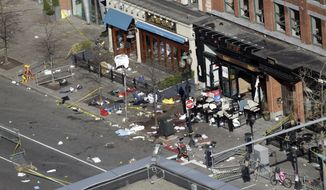One of the blast sites on Boylston Street near the finish line of the 2013 Boston Marathon is seen in Boston on Tuesday, April 16, 2013, one day after bombings killed three and injured more than 140 people. (AP Photo/Elise Amendola) ** FILE **