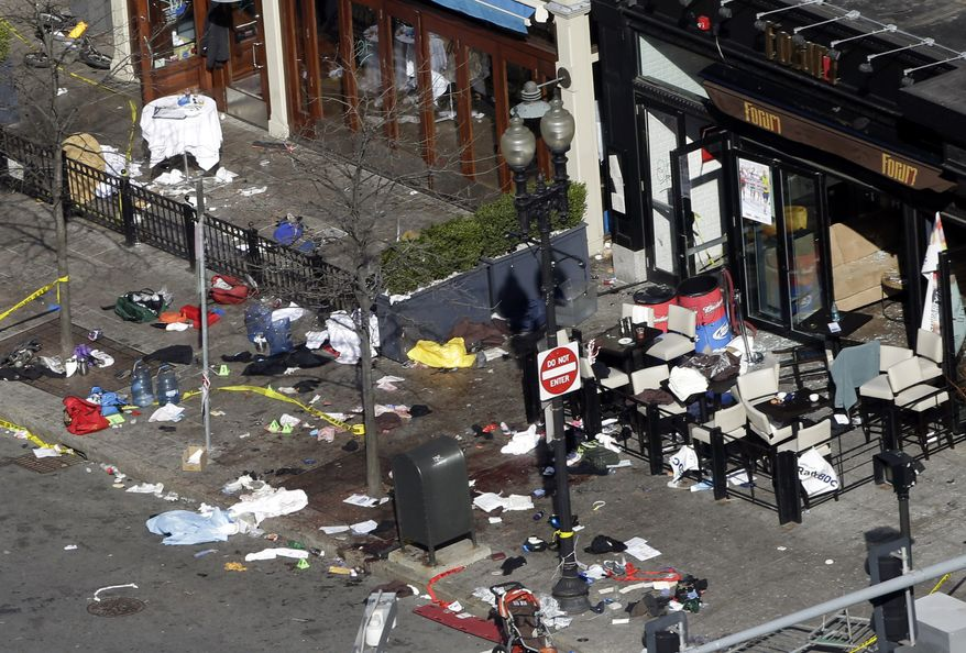 One of the blast sites on Boylston Street near the finish line of the 2013 Boston Marathon is seen in Boston on April 16, 2013, one day after bomb blasts killed three and injured more than 140 people. (Associated Press0
