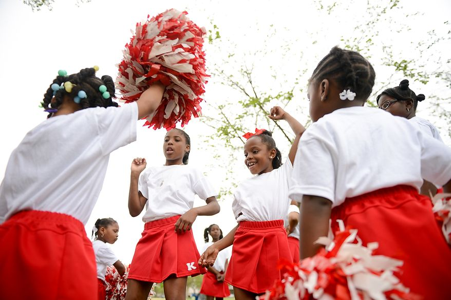 Martin Luther King Elementary School cheerleaders Jade Ferguson, 10, center left, and Kendra Johnson, 9, center, right, and others warm up before participating in the Washington, D.C. Emancipation Day parade, Washington, D.C., Tuesday, April 16, 2013. President Abraham Lincoln freed approximately 3,100 slaves in the District of Colombia on April 16, 1862, nine months before the Emancipation Proclamation. (Andrew Harnik/The Washington Times)