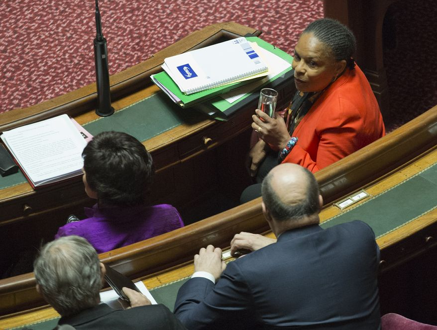 ** FILE ** French Justice Minister Christiane Taubira (right) attends the debate in the French Senate on the legalization of same-sex marriage and adoption for same-sex couples, in Paris on Thursday, April 4, 2013. (AP Photo/ Jacques Brinon)