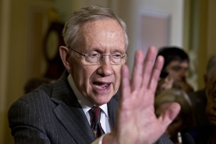** FILE ** Senate Majority Leader Harry Reid, Nevada Democrat, speaks with reporters following a Democratic strategy session at the Capitol in Washington on Tuesday, A