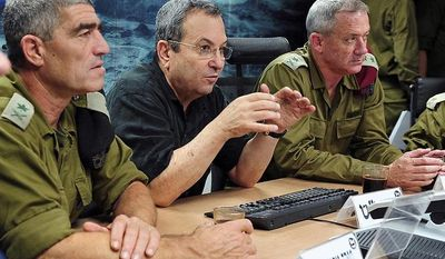 ** FILE ** In this photo made available by the Israeli Defense Ministry, Defense minister Ehud Barak (center), Chief of Staff Benny Gantz (right) and head of Israel's Southern Command Tal Tousso attend a briefing in Beersheba, Israel, on Nov. 15, 2012.  (Associated Press/Ariel Hermoni, Israeli Defense Ministry)