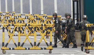 """South Korean Army soldiers patrol on Unification Bridge in Paju, South Korea, near the border village of Panmunjom, Tuesday, April 16, 2013. North Korea's state media said Tuesday the Supreme Command of the Korean People's Army issued an ultimatum demanding an apology from South Korea for """"hostile acts"""" and threatening that unspecified retaliatory actions would happen at any time. (AP Photo/Ahn Young-joon)"""
