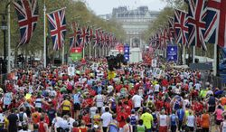 """FILE - In this April 25, 2010 file photo, competitors make their way from the finish area at the London Marathon. Determined to put on a show of """"solidarity"""" for Boston, London Marathon organizers will stage the race on Sunday, April 21, 2013. The British capital has long been a top target for terrorists, and these concerns have only intensified after harrowing scenes from the Boston Marathon on Monday, April 15, 2013,where bombs killed three people and injured more than 170. (AP Photo/Tom Hevezi, File)"""