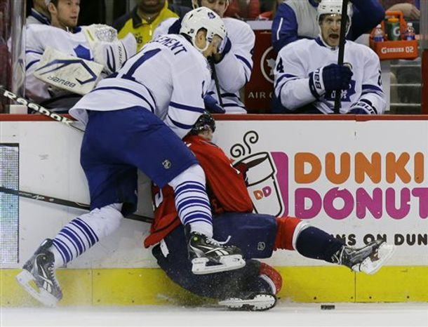 Toronto Maple Leafs center Jay McClement (11) hits Washington Capitals center Nicklas Backstrom (19), from Sweden, into the boards in the first period of an NHL hockey game Tuesday, April 16, 2013 in Washington. (AP Photo/Alex Brandon)
