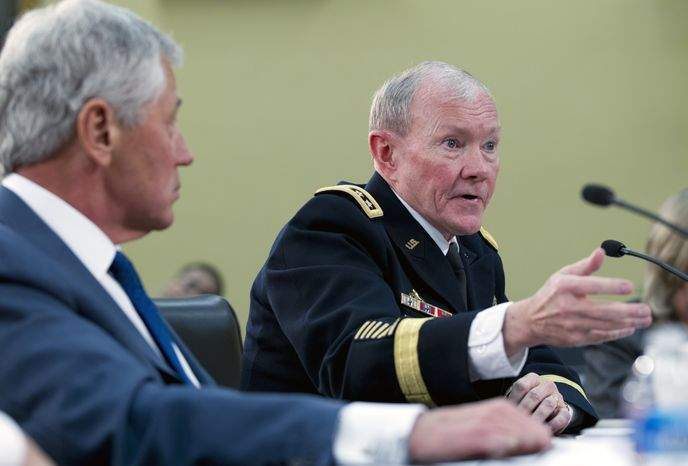 Army Gen. Martin E. Dempsey (right), chairman of the Joint Chiefs of Staff, testifies on Capitol Hill in Washington on Tuesday, April 16, 2013, before the House Defense subcommittee hearing on the Pentagon's fiscal 2014 budget. Defense Secretary Chuck Hagel is at left. (AP Photo/Jose Luis Magana)