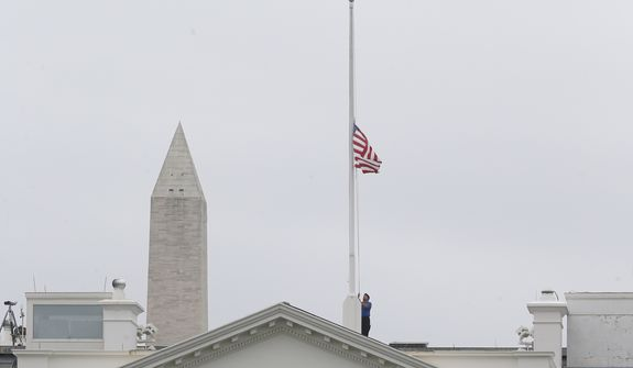 The American flag is lowered at the White House in Washington on April 16, 2013, honoring the victims of the tragedy in Boston. President Obama ordered flags at the White House and all government buildings to be flown at half-staff in honor of the Boston Marathon explosion victims. (Associated Press)
