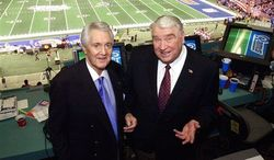 Pat Summerall, left, and John Madden stand in the booth at Louisiana Superdome before the NFL Super Bowl XXXVI football game in New Orleans, Feb. 3, 2002. Fox Sports spokesman Dan Bell said Tuesday, April 16, 2013, that Summerall, the NFL player-turned-broadcaster whose deep, resonant voice called games for more than 40 years, has died at the age of 82. (Associated Press)