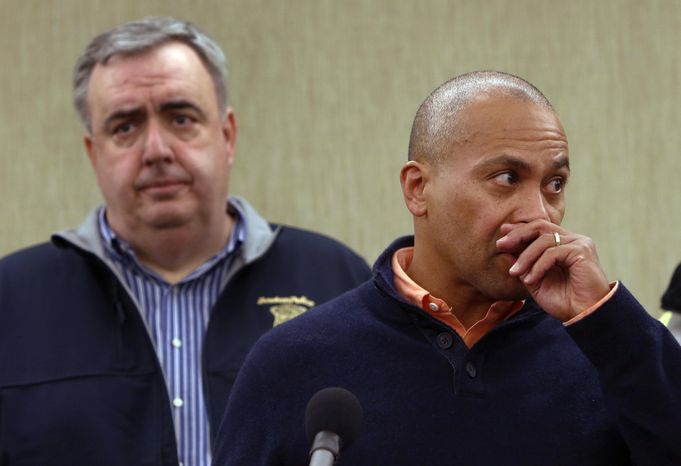 ** FILE ** Massachusetts Gov. Deval Patrick pauses as he speaks about the explosions during a news conference as Boston Police Commissioner Edward Davis, left, looks on, Monday, April 15, 2013, in Boston. Two explosions shattered the finish of the Boston Marathon. (AP Photo/Bizuayehu Tesfaye)