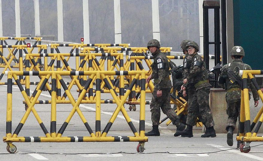"""South Korean Army soldiers patrol on Unification Bridge in Paju, South Korea, near the border village of Panmunjom, on April 16, 2013. North Korea's state media said the Supreme Command of the Korean People's Army issued an ultimatum demanding an apology from South Korea for """"hostile acts"""" and threatening that unspecified retaliatory actions would happen at any time. (Associated Press)"""
