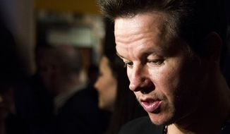 "Mark Wahlberg attends a screening of ""Pain & Gain"" on Monday, April 15, 2013 in New York. (Photo by Charles Sykes/Invision/AP)"