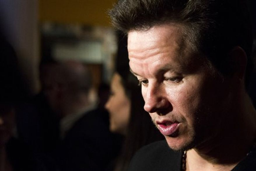"""Mark Wahlberg attends a screening of """"Pain & Gain"""" on Monday, April 15, 2013 in New York. (Photo by Charles Sykes/Invision/AP)"""