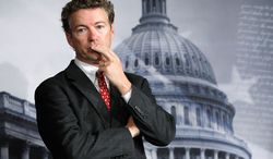 Sen. Rand Paul, Kentucky Republican, said he is still torn on what to do with some of the enemy combatants in the war on terrorism captured overseas the U.S. holds. His father, Ron Paul, advocates closing the Guantanamo Bay prison. (Associated Press)