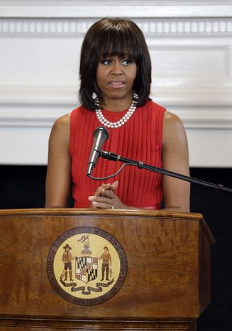 ** FILE ** First lady Michelle Obama speaks during a bill signing ceremony for Maryland's Veterans Full Employment Act of 2013 at the Maryland State House in Annapolis on April 17, 2013. (Associated Press)
