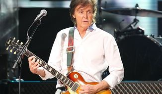 ** FILE ** Paul McCartney performs at the 12-12-12 The Concert for Sandy Relief at Madison Square Garden in New York on Wednesday, Dec. 12, 2012. (AP Photo/Starpix, Dave Allocca)