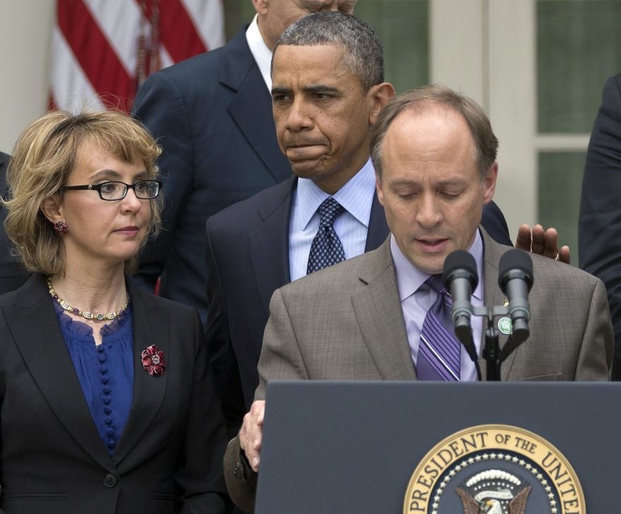 ** FILE ** President Obama arrives to participate in a news conference in the Rose Garden of the White House on April 17, 2013, about measures to reduce gun violence. With Obama is former Rep. Gabby Giffords (left) and Mark Barden, the father of Newtown shooting victim Daniel. (Associated Press)