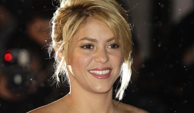 Colombian singer Shakira arrives at the Cannes Festival Palace to take part in the NRJ Music awards ceremony in Cannes, France, in January 2012. (AP Photo/Lionel Cironneau)