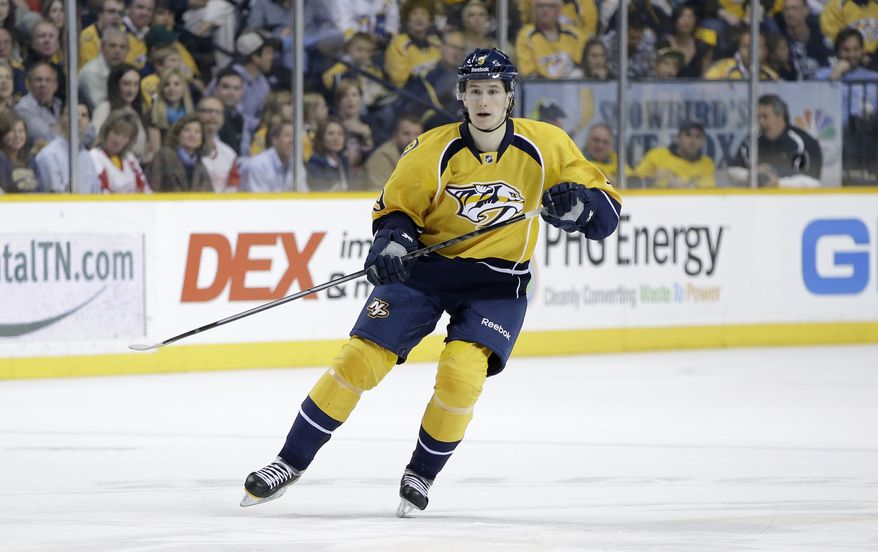 Nashville Predators forward Filip Forsberg (9), of Sweden, plays against the Detroit Red Wings in the second period of an NHL hockey game on Sunday, April 14, 2013, in Nashville, Tenn. (AP Photo/Mark Humphrey)