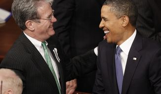 **FILE** President Obama greets Sen. Tom Coburn, Oklahoma Republican, on Capitol Hill in Washington on Jan. 25, 2011, before the president delivered his State of the Union address. (Associated Press)