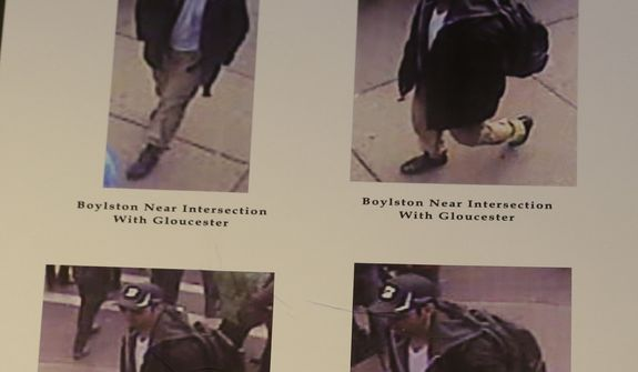 Photos of one of two suspects sought in the Boston Marathon bombing is displayed during a news conference talking about the investigation of the Boston Marathon explosions on April 18, 2013, in Boston. (Associated Press)