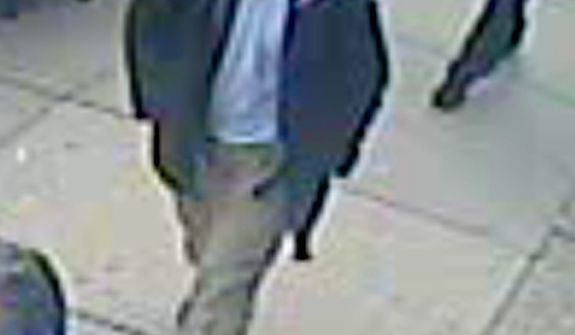 This image released by the FBI on Thursday, April 18, 2013, shows in a image from video what the FBI is calling suspect number 1 with a black hat walking with a backpack in Boston on Monday, April 15, 2013, before the explosions at the Boston Marathon. (AP Photo/FBI)