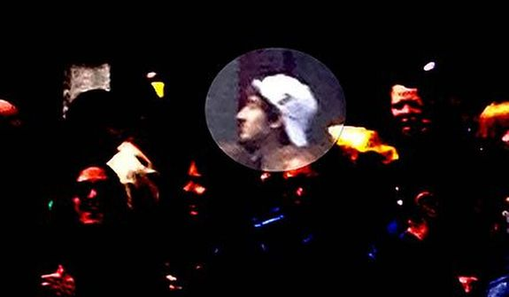 This image released by the FBI on Thursday, April 18, 2013, shows in a image from video what the FBI is calling suspect number 2, highlighted, with a white hat walking in Boston on Monday, April 15, 2013, before the explosions at the Boston Marathon. (AP Photo/FBI)