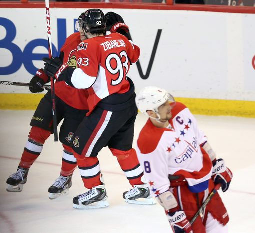 Ottawa Senators' Cory Conancher (89) and Mika Zibanjed (93) celebrate Conancher's goal as Washington Capitals' Alex Ovechkin (8) skates away during the second period of an NHL hockey game in Ottawa, Ontario on Thursday April 18, 2013. (AP Photo/The Canadian Press, Fred Chartrand)