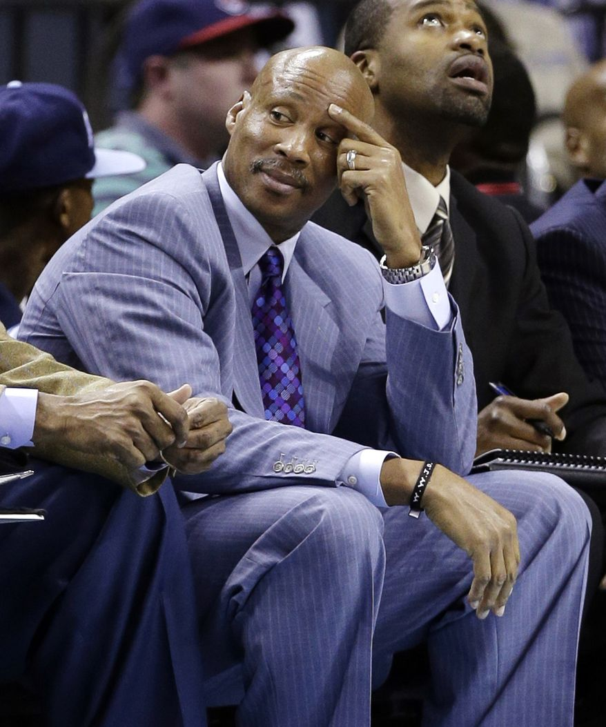 Cleveland Cavaliers head coach Byron Scott watches from the bench during the first half of an NBA basketball game against the Charlotte Bobcats in Charlotte, N.C., Wednesday, April 17, 2013. (AP Photo/Chuck Burton)