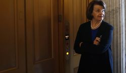 ** FILE ** Sen. Dianne Feinstein, D-Calif., waits for an elevator on Capitol Hill in Washington, Wednesday, April 17, 2013, after speaking about gun legislation on the Senate floor. (AP Photo/Charles Dharapak)