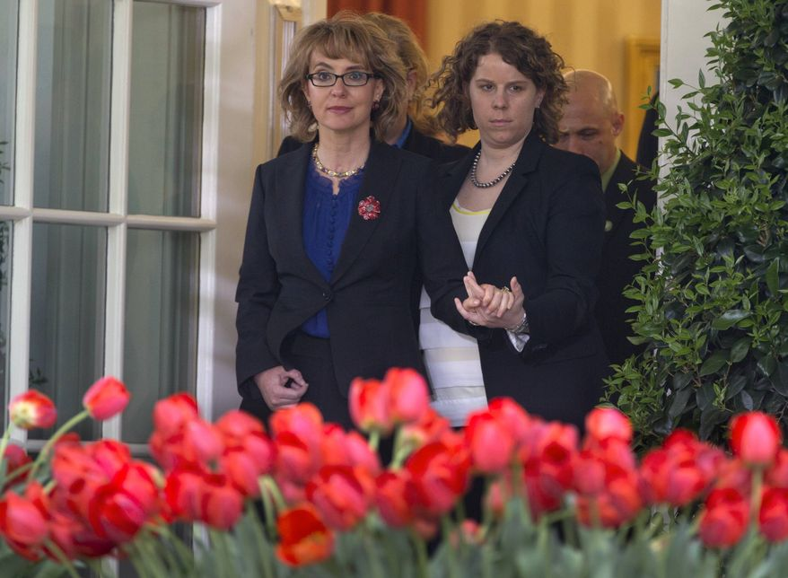 Former Rep. Gabby Giffords is helped as she arrives for a news conference in the Rose Garden of the White House, Wednesday, April 17, 2013, in Washington, about measures to reduce gun violence and the bill to expand background checks on guns that was defeated in the Senate. (AP Photo/Carolyn Kaster)