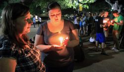 Baylor University students hold a candlelight vigil outside Waco Hall for the victims of the West, Texas, fertilizer plant explosion on April 17, 2013. (Associated Press/Waco Tribune Herald)