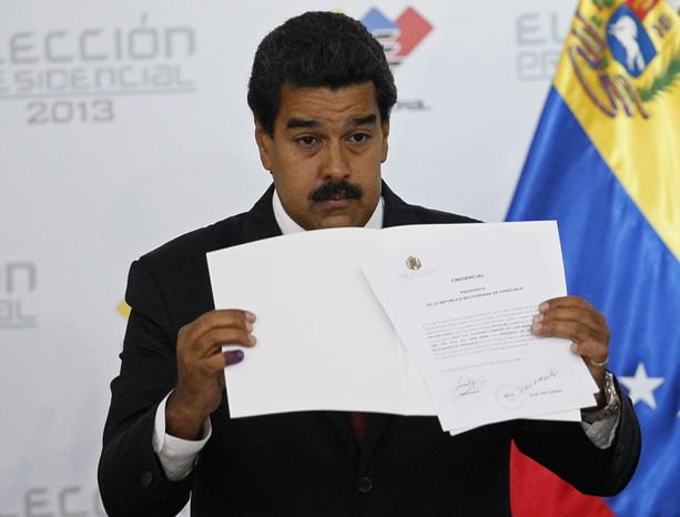 ** FILE ** Venezuelan Interim President Nicolas Maduro holds the official certificate declaring him the winner of the presidential election, at the Electoral Council in Caracas, Venezuela, on Monday, April 15, 2013. The nation's government-friendly Electoral Council quickly certified the razor-thin presidential victory of the late President Hugo Chavez&