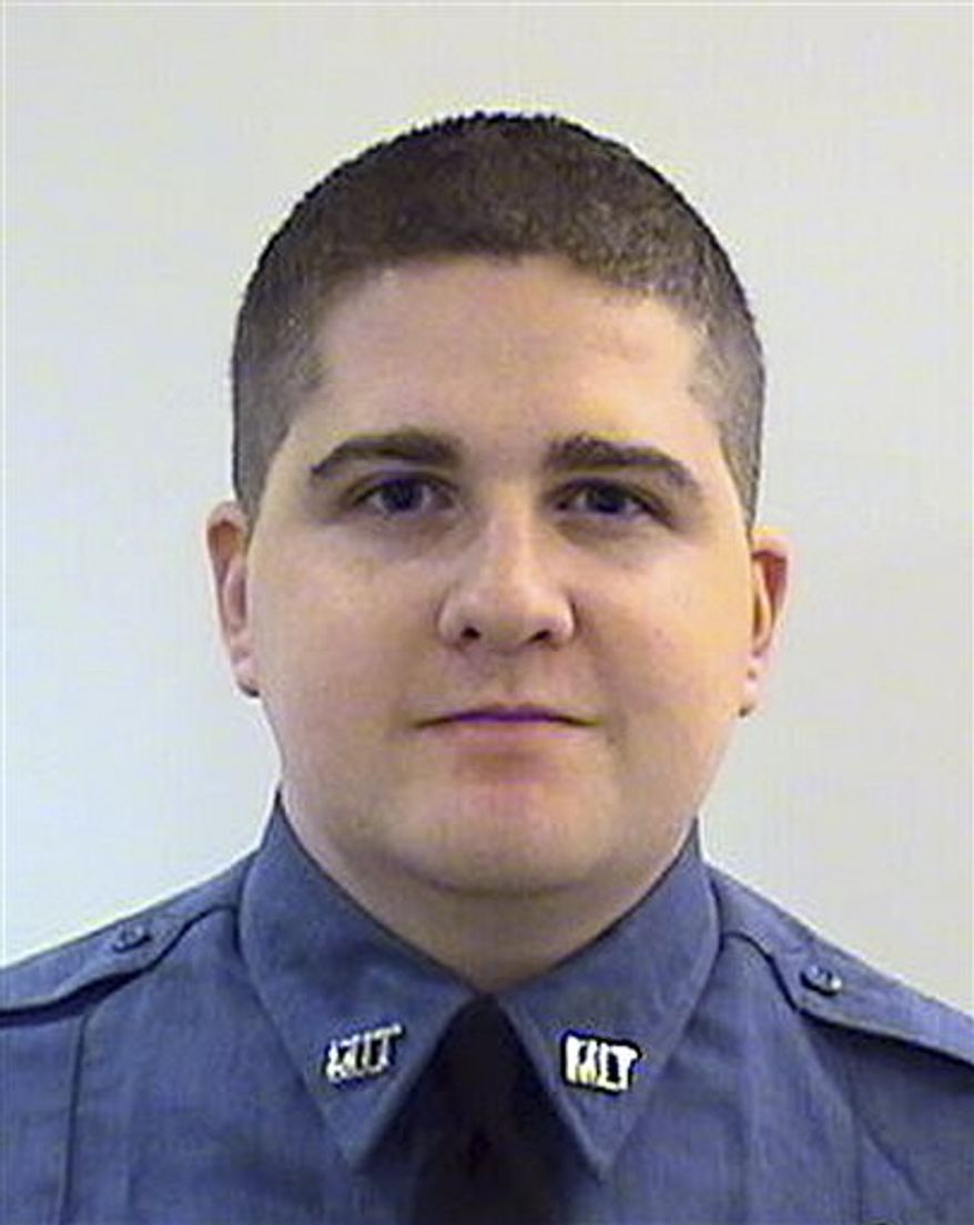 This undated photo provided by the Middlesex District Attorney's Office shows Massachusetts Institute of Technology Police Officer Sean Collier, 26, of Somerville, Mass., who was shot to death Thursday, April 18, 2013 on the school campus in Cambridge, Mass. Authorities said surveillance tape recorded late Thursday showed one of the Boston Marathon bombing suspects during a robbery of a nearby convenience store before Collier was shot to death while responding to a report of a disturbance. (AP Photo/Middlesex District Attorney's Office)