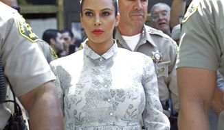 **FILE** TV personality Kim Kardashian leaves Los Angeles County Superior Court after a hearing in her divorce from Kris Humphries on April 12, 2013. Humphries, a power forward for the Brooklyn Nets, did not attend the hearing. The reality star wants a divorce to end her 72-day marriage to Humphries, but the NBA player wants it annulled. (Associated Press)