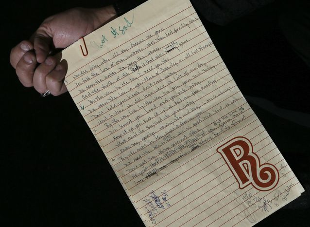 Handwritten lyrics and notes by Brian Wilson from his notebook are displayed in London on April 18, 2013. A large collection of the Beach Boys' early compositions, contracts, publishing agreements, handwritten songs and musi