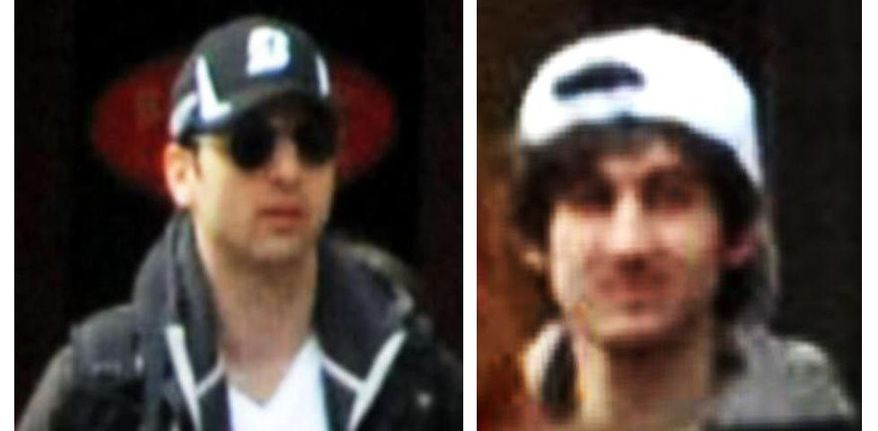 This combo of photos released by the FBI early Friday April 19, 2013, shows what the FBI is calling Suspects No. 1, left, and No. 2, right, walking through the crowd in Boston on Monday, April 15, 2013, before the explosions at the Boston Marathon. (AP Photo/FBI)