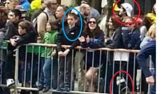 This photograph, taken from a surveillance camera in Boston and posted on Twitter, shows one of the suspects of the Boston Marathon bombing in the same frame with a boy who appears to be 8-year-old Martin Richard, who was killed in one of the blasts. The circle at bottom right appears to be a backpack or a package. (Credit: Twitter)