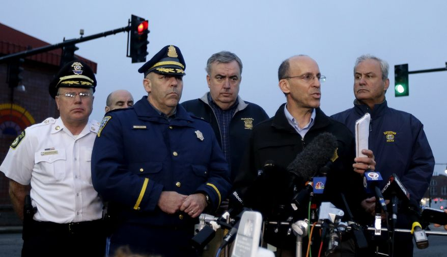 Officials address the media during a news conference in Watertown, Mass., Friday, April 19, 2013. Officials are urging residents of Watertown and surrounding towns to stay indoors. (AP Photo/Julio Cortez)