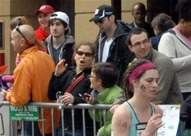 ** FILE ** Runner Bob Leonard captured pictures of the Boston Marathon bombing suspects on April 15, 2013, in Boston. Tamerlan Tsarnaev (third from left), who was dubbed Suspect No. 1, and his brother, Dzhokhar  Tsarnaev, who