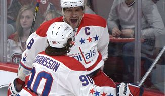 Washington Capitals' Alexander Ovechkin celebrates with teammate Marcus Johansson (90) after scoring against the Montreal Canadiens during first period NHL hockey action in Montreal, Saturday, April 20, 2013. (AP Photo/The Canadian Press, Graham Hughes)