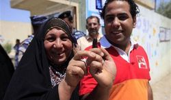 Iraqis display their ink-stained fingers at a polling center during the country's provincial elections in Baghdad, Iraq, Saturday, April 20, 2013. (AP Photo/ Karim Kadim)