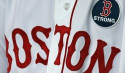 Boston Red Sox's Pedro Ciriaco wears a 'B strong patch during a baseball game between the Boston Red Sox and the Kansas City Royals in Boston, Saturday, April 20, 2013. (AP Photo/Michael Dwyer)