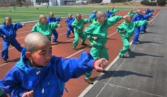 Eleven-year-old students at the Mangyongdae Revolutionary School, in Pyongyang, North Korea practice taekwondo, April 18, 2013. (AP Photo)