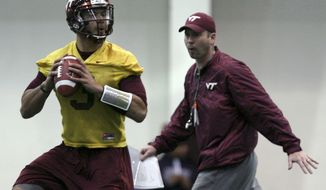 **FILE** Quarterback Logan Thomas (3) left, prepares to throw as new offensive coordinator and quarterbacks coach Scot Loeffler watches during Virginia Tech's spring NCAA college football practice in Blacksburg, Va. on Wednesday, March 27 2013. (AP Photo/ The Roanoke Times, Matt Gentry)