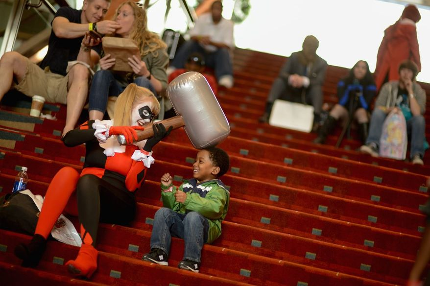 """Teen Titans and Young Justice characters (left) get into a playful argument with Batman villains while waiting for the costume contest to begin Sunday at Awesome Con D.C., a comic book convention at the Washington Convention Center. """"People forget this culture exists,"""" Ariel Casey of Rockville said."""