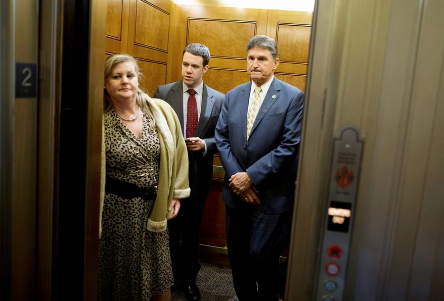 """Sen. Joe Manchin III, West Virginia Democrat (right), a lifelong hunter and NRA member, plans to """"go to every gun show"""" in the country in his effort to convince doubters  including NRA members  of the Senate background-check bill's merit."""