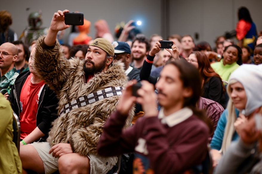 Will Makaneole of Dumfries, Va., wears a Wookie-like jacket from the Star Wars movies as he photographs a group posing during a costume contest at Awesome Con D.C., a comic book convention at the Washington Convention Center, Washington, D.C., Sunday, April 21, 2013. (Andrew Harnik/The Washington Times)
