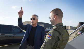 Secretary of Defense Chuck Hagel gestures before boarding an aircraft at Andrews Air Force Base in Washington's Maryland suburbs on Saturday, April 20, 2013, for a trip to the Middle East. (AP Photo/Jim Watson, Pool)