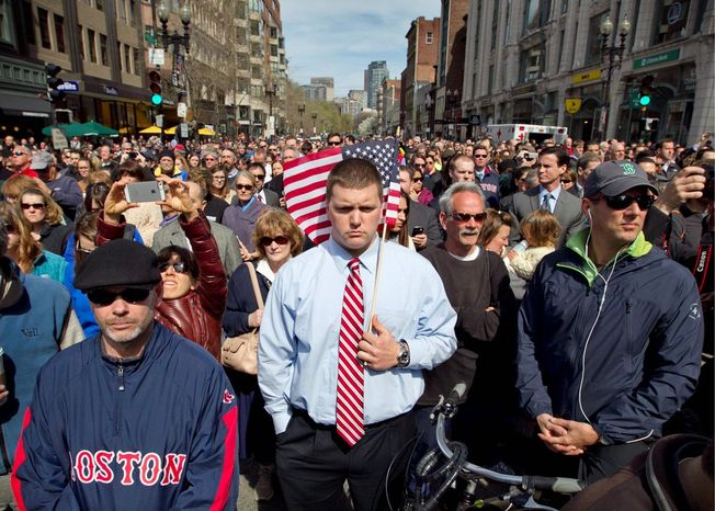 A moment of silence in honor of the victims of the Boston Marathon bombing is observed at 2:50 p.m. Monday on Boylston Street ne